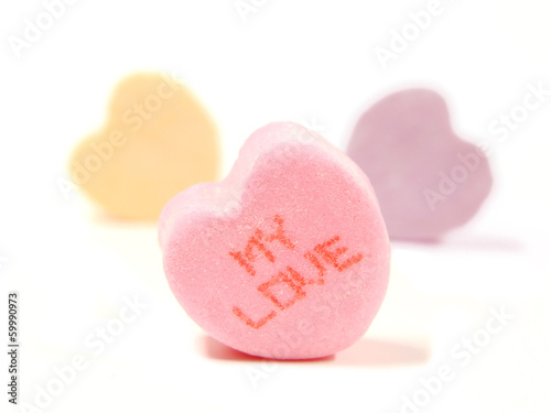 "Heart-shaped Valentines candies with ""MY LOVE"" text"