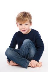 Cute Boy Sitting Cross Legged.