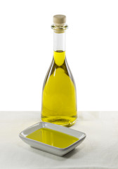 Olive oil in glass bottle and dish