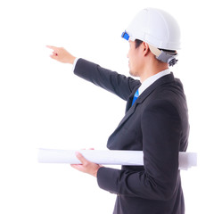 engineer holding plan and pointing to construction site isolated