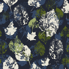Seamless texture with stamped autumn leaves.