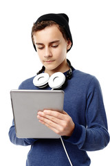 Trendy teenager with cap and headphones around the neck  working