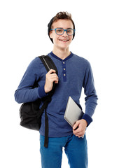 Cheerful teenager with backpack wearing cap and glasses and hold