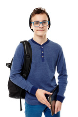 Trendy teenager with backpack wearing cap and glasses and holdin