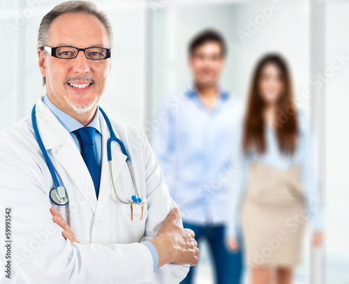 Doctor in front of a couple