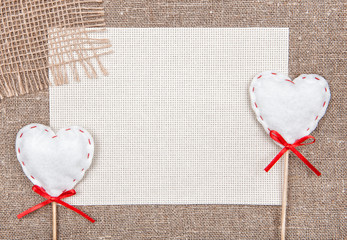 Valentine card with textile hearts and sacki