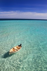 Boat drifting in the Maldives