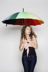 Young woman holding an umbrella
