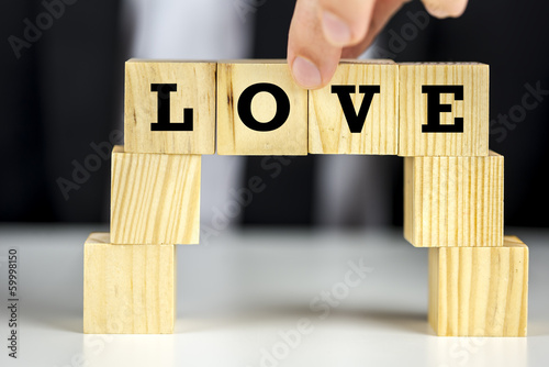 Love in alphabet letters on wooden blocks