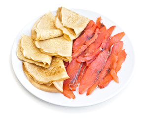 Russian pancakes with red fish - isolated