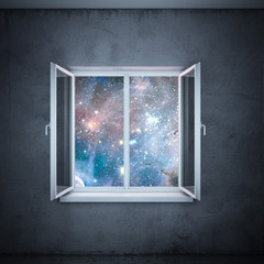 universe in window  (elements furnished by NASA)