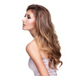 Profile of a beautiful woman with long wavy hair and makeup