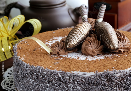 gourmet chocolate cake with festive decorations
