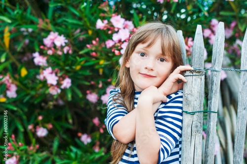 Close-up portrait of a cute little girl at summer vacation