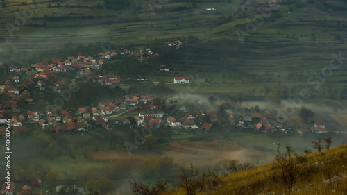 Transylvania Remetea village and valley covered in rolling  fog