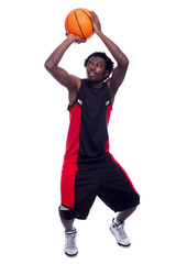 Basketball player with a ball, isolated on a white background