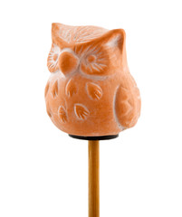 Owl in clay on wooden stick