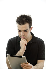 Portrait of a serious young man with tablet pc