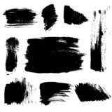 Set of abstract brush strokes on paper. Vector
