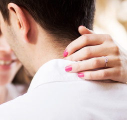 couple just about to kiss - focus on woman's hands with engageme