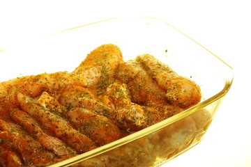 Closeup raw marinated chicken meat drumstick
