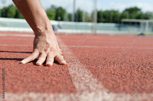 hand with running race track