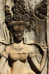 Stone ancient Apsara engraving on Angkor wat