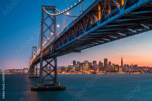 Tuinposter Bruggen San Francisco skyline framed by the Bay Bridge at sunset