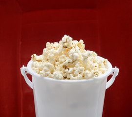 popcorn bucket made of plastic over red background