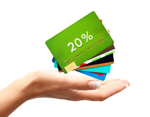 Woman hand with credit, discount cards isolated on white