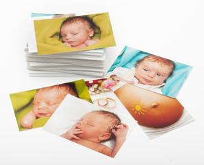 Pile of photographs on white background