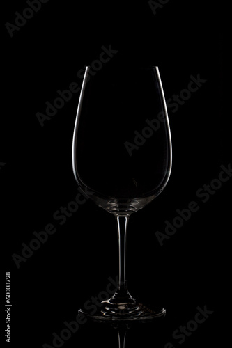 Empty wine glass on dark background