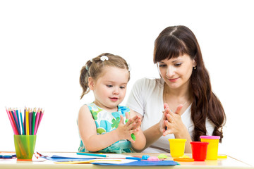 kid girl and mother play colorful clay toy