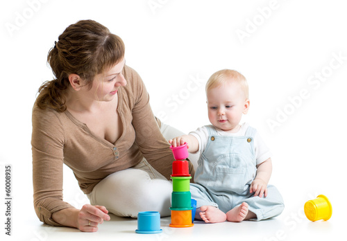 baby boy and mother play together with cup toys