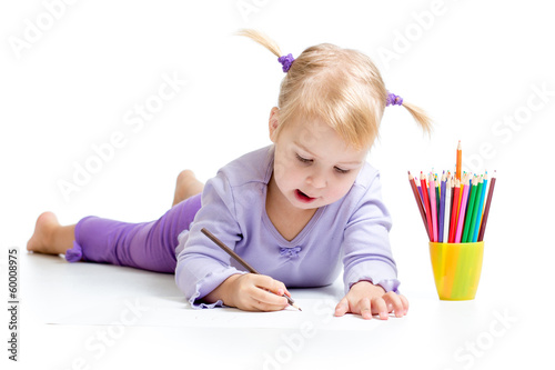 Cute kid drawing with color pencils