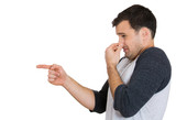 Man pinches his nose, something stinks, very bad smell