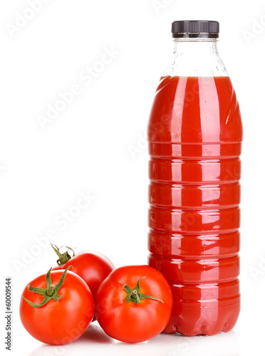 Tomato juice in bottle isolated on white