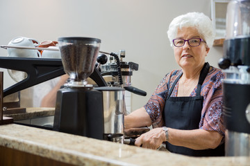 Portrait of Senior Barista Preparing Coffee