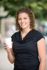 Woman Holding Disposable Coffee Cup Outdoors