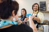 Barista Serving Customer