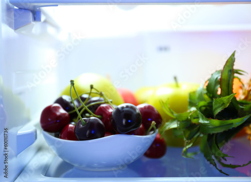 Fresh fruits on shelves in refrigerator