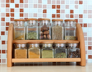 Set of spices in kitchen on table on mosaic tiles background