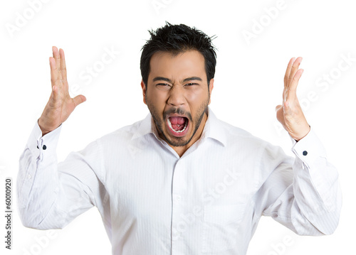 Angry, mad, frustrated young man screaming at someone