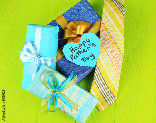Happy Fathers Day tag with gift boxes and tie,