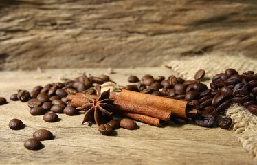 Roasted coffee beans  and spices on grunge wooden board  backgro