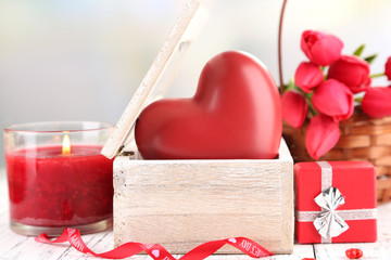 Romantic still life with heart in wooden casket