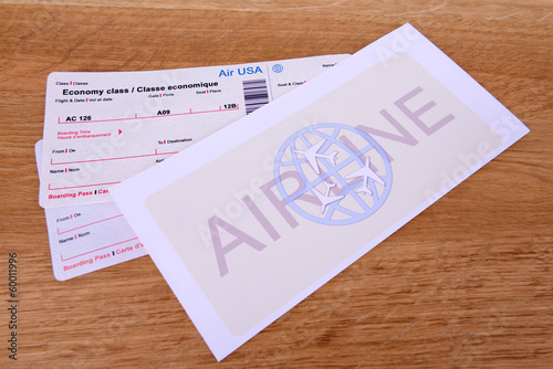 Airline tickets on table close-up