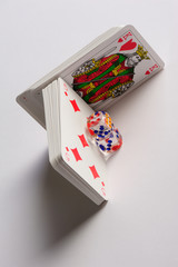 Gamble cards with dices isolated white backgraund