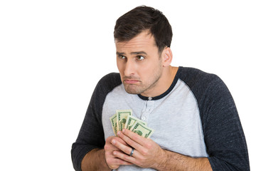 Greedy young man holding dollar bills, money