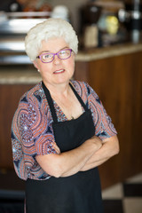 Owner With Arms Crossed Standing In Cafeteria